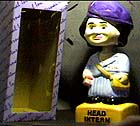 """Head Intern"" bobbing figure of Monica"
