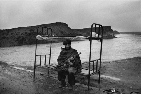 a mujahid of the hezbi-islami guards the road to the capital. afghanistan. near kabul (set of 6) by abbas