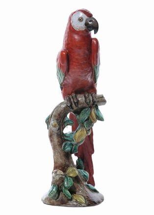 pappagallo appollaiato su un ramo fiorito by zaccagnini