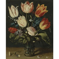 still life of tulips and other flowers in a glass vase by andries daniels