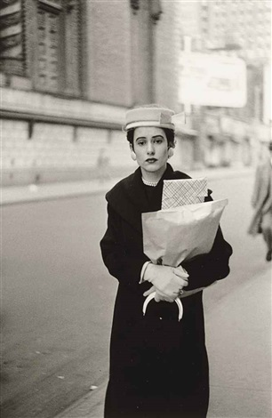 woman with parcels nyc by diane arbus