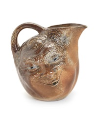 a large double-sided salt-glazed face jug by martin brothers
