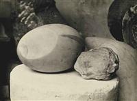 two sculptures: le nouveau né ii and l'enfant dormant, 1906, 1923 by constantin brancusi