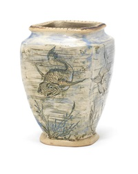 a stoneware vase with fish by martin brothers