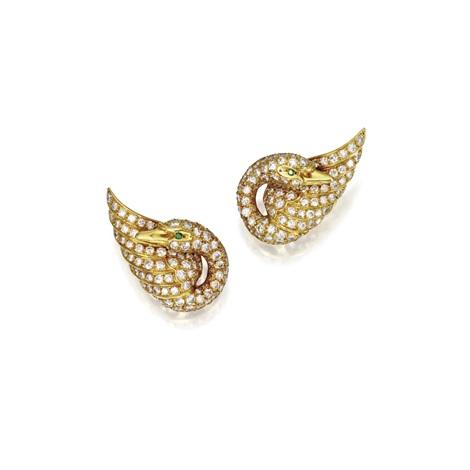 a pair of swan earclips by van cleef & arpels