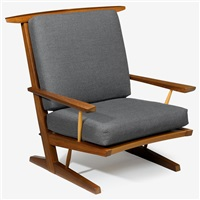 custom conoid cushion chair with arms by mira nakashima-yarnall