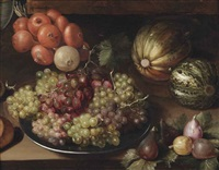white and red grapes on a pewter plate, a string of onions, two melons and figs, all on a wooden table by georg flegel