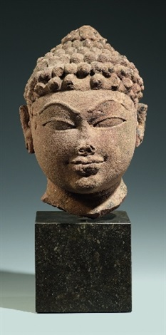 a rajasthani or madhya pradesh sandstone head of a deity 11th12th century