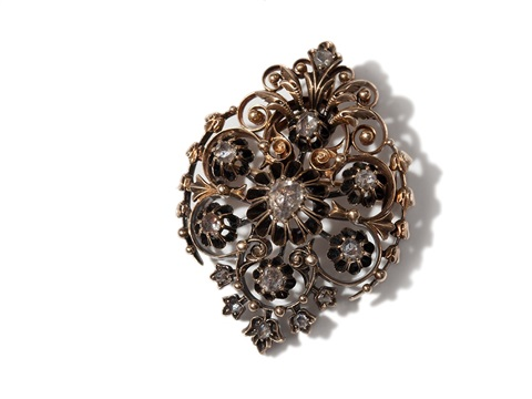 a fine filigree diamond brooch around 1880