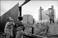children playing on deserted ground in docklands. england. london. (set of 11) by ian berry