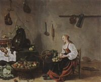 a kitchen interior with a maid cleaning turnips by sybrand van beest