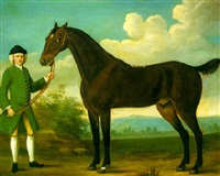 a bay racehorse held by a groom in landscape by richard roper