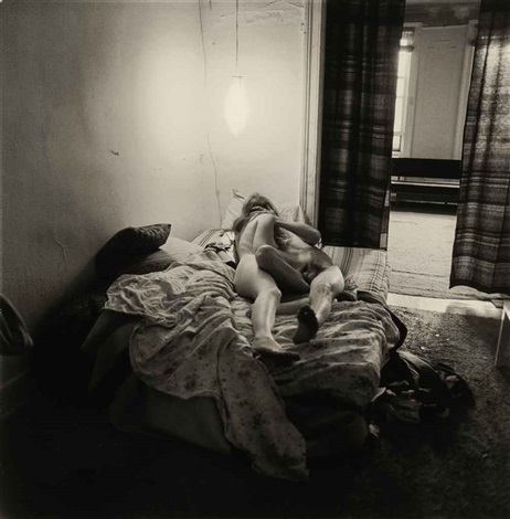 couple in bed under a paper lantern nyc by diane arbus