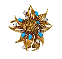 a brooch designed as a flowerhead by chaumet