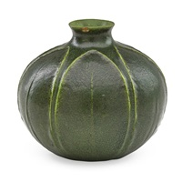 spherical vase carved with leaves by grueby