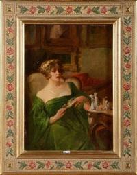 femme assise dans un intérieur by henri privat-livemont