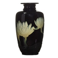 black iris vase with water lilies by j. d. wareham