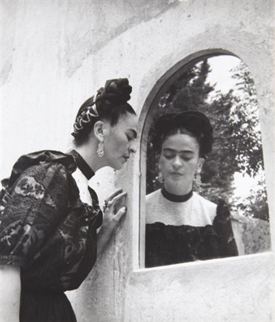 frida looking in mirror close up by lola alvarez bravo