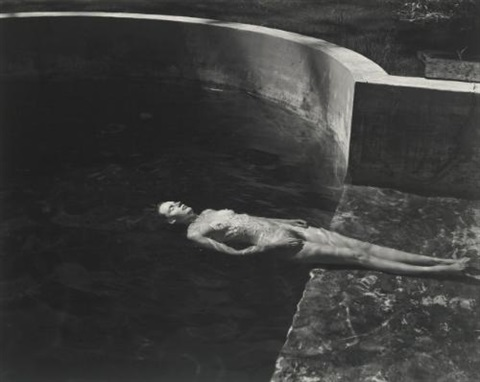 nude floating charis in the pool by edward weston