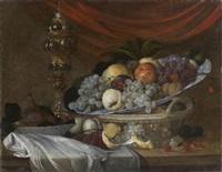 nature morte au plat de fruits et pokal sur un entablement by michiel simons