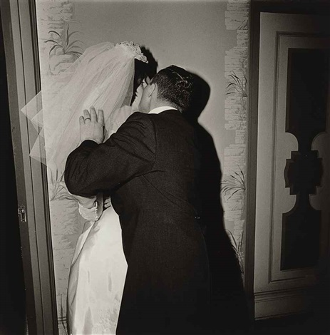 groom kissing his bride nyc by diane arbus