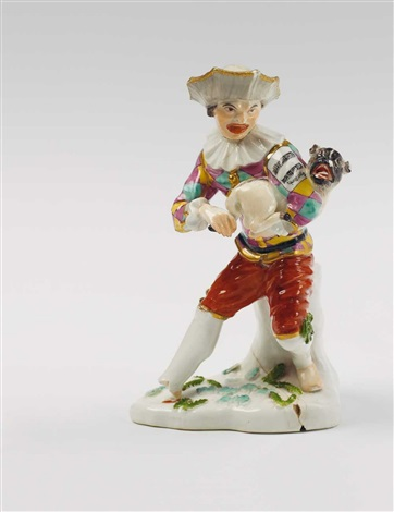 a meissen figure of a harlequin playing hurdy gurdy with a pug dog