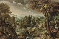 an extensive wooded river landscape with a traveller on a track, a town beyond by lucas van valkenborch