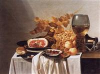 nature morte de fruits et jambon voisinant sur un entablement avec un pichet et un verre de vin by cornelis cruys