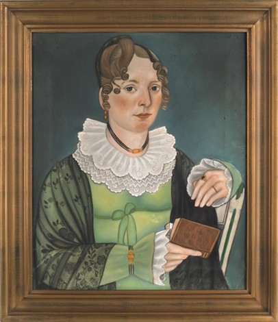 Portrait Of A Young Woman Holding A Book Wearing A Lime