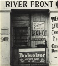 painted and posted advertisements on façade of river front coffee shop by walker evans