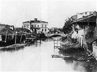 vue pittoresque de maisons au bord d'une rivière by ludwig angerer