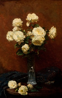 white roses in glass vase on table by paul arntzenius