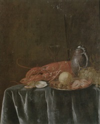 still life of a lemon, hazelnuts and a crab on a pewter dish, together with a lobster, oysters, wine glasses, grapes all upon a draped table by philips gysels