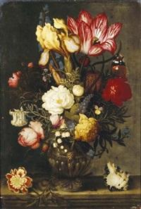 bouquet de fleurs dans un vase de bronze posé sur un entablement près d'un coquillage by ambrosius bosschaert the elder