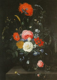 a still life of flowers in a glass vase on a stone ledge by hendrik schoock