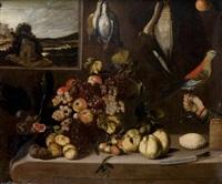 nature morte de coings et figues avec un panier de raisins et pommes sur un entablement devant une fenêtre ouverte sur un paysage by alejandro de loarte