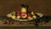 a still life of apples and pears in a blue and white porcelain bowl, gooseberries, hazelnuts and walnuts, on a stone ledge by johannes bouman
