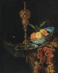 a still life with a bowl of oranges, a pewter plate and a gilt cup by christian striep
