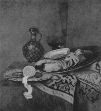 still life of a lobster, porcelain platter, peeled lemon on a silver plate with a jug and glasses beyond, on a ledge draped with an oriental rug by pieter gallis