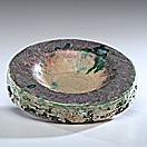 multi-colored flat bowl by glen lukens
