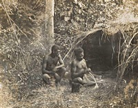 two north east queensland aboriginal men, one making a bi-cornual basket by alfred atkinson