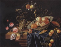 coupe de fruits et de fleurs sur un entablement by karel batist