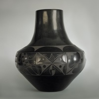 black on black vase by carmelita dunlap