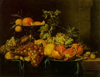 oranges dans une tazza, grenades sur une assiette en etain, raisins, citrons, noix et un couteau sur un rebord by hendrik schoock