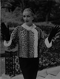 denise en veste cardigan d'ocelot bordée d'hermine, givenchy by pierre andré
