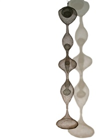 hanging five-lobed continuous form with spheres inside four of the lobes, two of the inside spheres containing spheres within them by ruth asawa