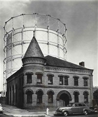 the san francisco gas and light company (cylindrical building behind older building) by john gutmann