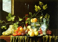 still life of fruit, a covered pitcher, a wine flute, a roemer and two wood boxes, all on a draped table near an open window by theodor van aenvack