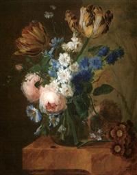 nature mort au bouquet dans un vase en verre sur un entablement de marbre by pieter faes