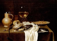 a still life with a stoneware jug, a flute, a roemer, shrimps, bread and tobacco on pewter plates, shrimps in a wan-li porcelain bowl, together with a knife, all on a draped table by maerten boelema de stomme